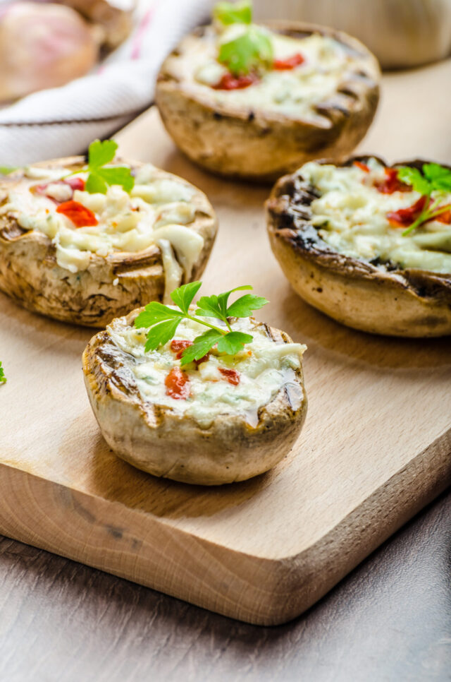 Grilled mushrooms stuffed with blue cheese and chilli and garlic toast