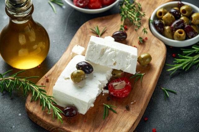 Greek cheese feta with thyme, rosemary, olives and stuffed red bell peppers.
